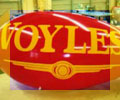 red advertising blimp with Voyles logo